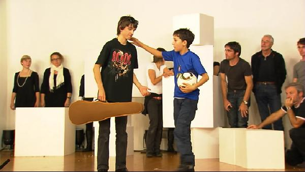 Durant la prova dal musical-teater